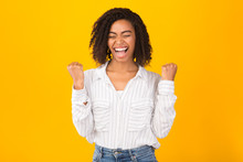 Overjoyed Young Black Girl Scr...