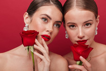 Two Women With Bright Red Lipstick Holding Roses.