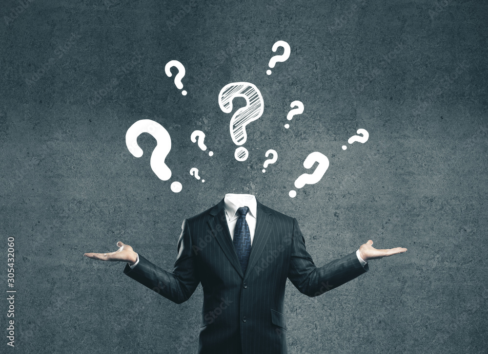 Fototapeta young businessman with question mark