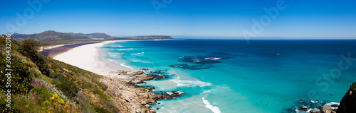 Panoramic of surfers at Noordhoek Beach, Cape Town Fotobehang