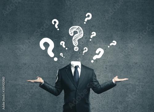 Fototapeta young businessman with question mark obraz