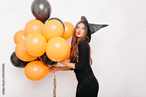 Pinturas sobre lienzo  Elegant girl with long hair posing on white background at party