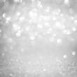 Abstract glitter bokeh on black background