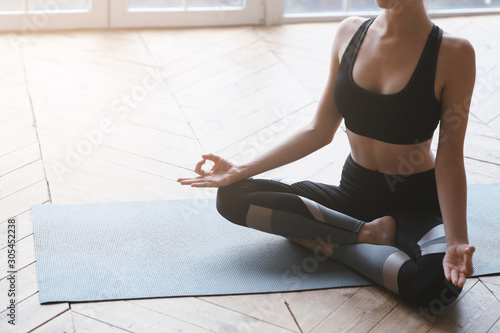 Cropped photo of fit girl sitting in lotus pose - 305452238