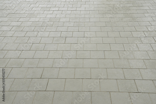 Old road grey mosaic pavement texture