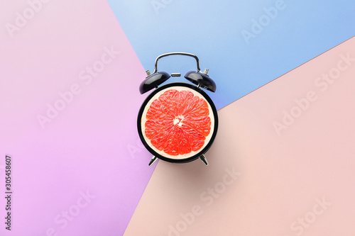 Alarm clock on color background - 305458607