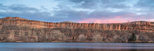 Calm Dusk Over Sandstone Cliff And Lake