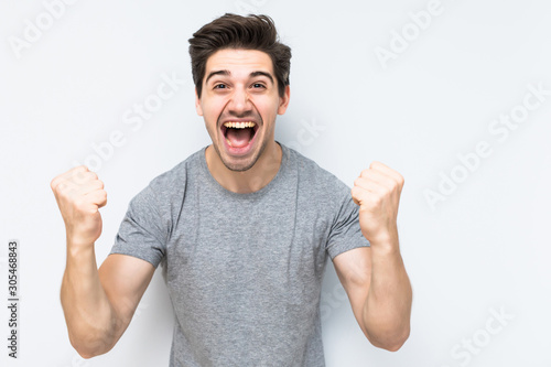 Portrait of smiling man with the fists up isolated a white background Fototapet