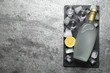 Cold Russian vodka on grey table, top view. Space for text