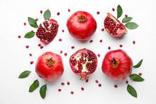 Ripe Tasty Pomegranates On White Background