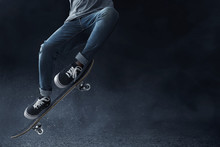 Skateboarder Skateboarding On The Street
