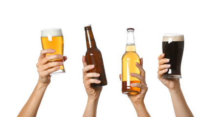 Hands with beer on white background