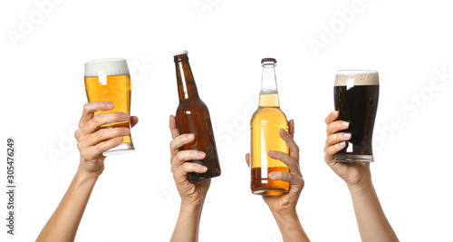 Obraz na plátně Hands with beer on white background