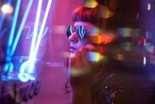 Girl With Sunglasses And Fringe Looking At Neon Lights