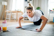 Young Woman Doing Exercise On ...