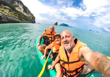 Senior Mother And Father With Son Taking Selfie At Kayak Excursion In Thailand - Adventure Travel In South East Asia - Elderly And Family Concept Of Love Sharing Moments With Parents - Warm Vivid Look