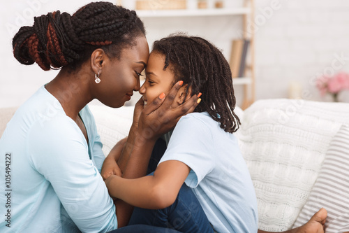 Canvas Print Loving african mom spending time with child