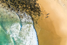 Aerial View Of Two Surfers Silhouette At Alexandria Beach, Noosa, Australia.