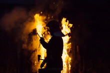 Firefighter Puts Out A Fire At...