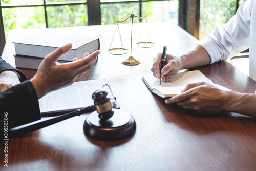Fototapeta Professional male lawyer or counselor discussing negotiation legal case with cli