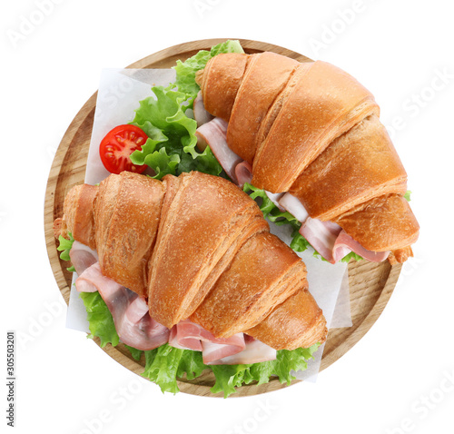 Obraz na plátně  Wooden tray with tasty croissant sandwiches isolated on white, top view