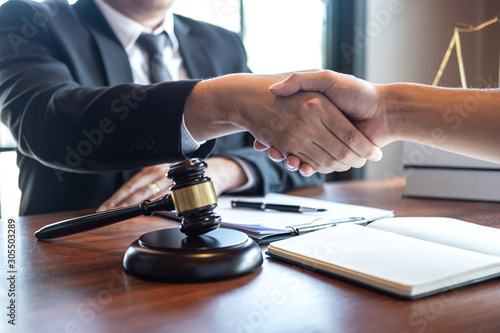 Handshake after good deal negotiation cooperation, Professional male lawyer or c Wallpaper Mural