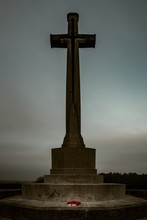 Vertical Shot Of A Huge Cross-shaped Monument In The Canadian War Cemetery In Groesbeek