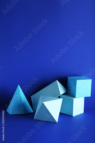 Fototapety, obrazy: Paper geometric figures on blue background