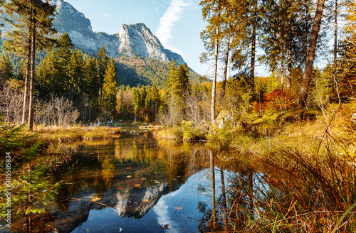 Wall mural - Scenic image at the Mountain lake Hintersee in the Bavarian Alps during a vibrant sunny Sunrise. Hintersee lake, Bavaria. Germany. Europe. Beautiful natural image. Incredible Nature Landscape