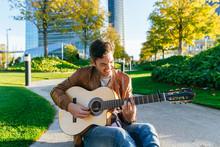 Man Playing Guitar In An Urban Park, Madrid, Spain