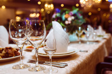 Serving Wedding Table. Sparkling Glassware Stands On Long Table Prepared For Wedding Dinner. Banquet.
