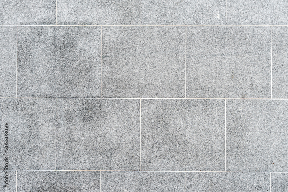 Fototapeta Texture of gray road granite tiles with white seams. Stone background.