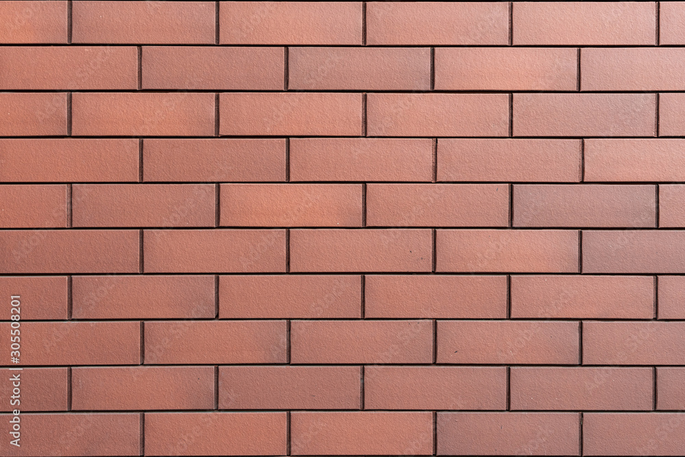 Wall texture of new modern brown brick. Building surface background. Classic brickwall.