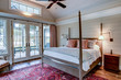 Beautiful luxury bedroom with view out onto waterfront and river.