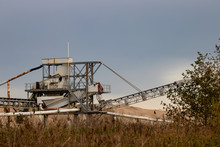 Sand Dredger With Mounds Of Sand In Background