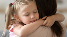 Grateful Little Child Girl Cute Face Embrace Loving Foster Mother