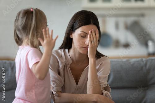 Billede på lærred Tired single mother feel desperate about screaming kid daughter