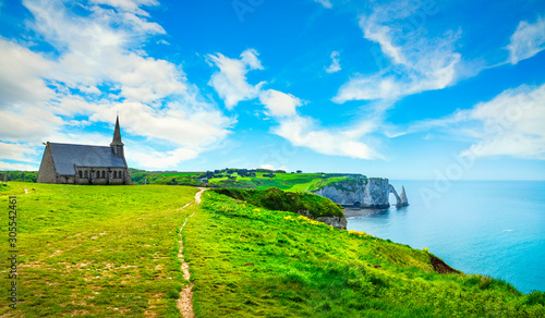 Etretat village, Church and Aval cliff. Normandy, France. Wallpaper Mural