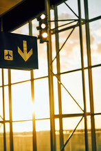 Black Sign With Yellow Arrow Pointing Direction And Airplane Location In Airport Texas
