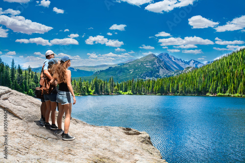Family enjoying time together on hiking trip Wallpaper Mural
