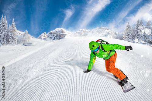 Fotomural Man snowboarder riding on slope.