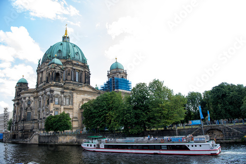 Fotobehang Berlijn Berlin, Germany - July 21, 2019: protestant church seen from river. Cathedral or dom. Religious building. Baroque architecture. Architectural monument. Vacation and travel. Wanderlust. River cruise