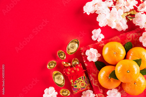 Fototapety, obrazy: Chinese new year festival decorations pow or red packet, orange and gold ingots or golden lump on a red background. Chinese characters FU in the article refer to fortune good luck, wealth, money flow.