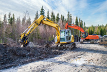 Yellow And Orange Excavator Building A Road Deep In The Forest. Rusko, Finland.