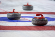 Curling Rock On The Ice