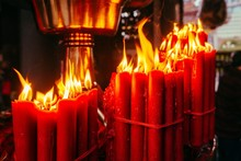 Closeup Of Burning Red Candles