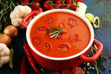 Tomato And Fresh Rosemary Soup With Garlic, Cracked Papper Corns, Served With Cream. Homade Tomato Soup For Dinner