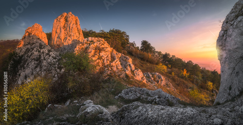 Recess Fitting Deep brown Rock Formation on the Hill in Palava Protected Area Illuminated by Setting Sun in South Moravia, Czech Republic