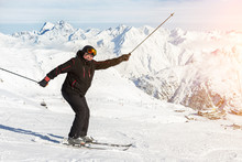 Senior Mature Happy Funny Skier Having Fun And Fooling Around At Winter Alpine Skiing Resort. Old Aged Sporty Person Enjoy Vacation At Mountain Alps Snow Slope Outdoors During Cold Snowy Day