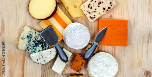 Fotografie, Obraz Cheese platter feast - cheese board / selection - cheddar, gloucester, stilton, gorgonzola, red leicester, feta, roule, camembert, brie, smoked, spicy